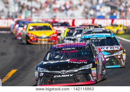 Watkins Glen, NY - Aug 07, 2016: Denny Hamlin leads the pack in the FedEx Freight Toyota  during the CHEEZ-IT 355 at the Glen weekend at the Watkins Glen International in Watkins Glen, NY.