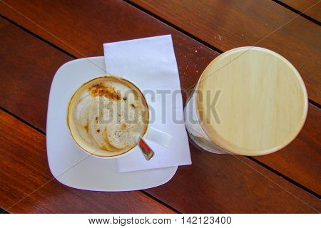 cup of coffee on wooden table Top view a cup of coffee