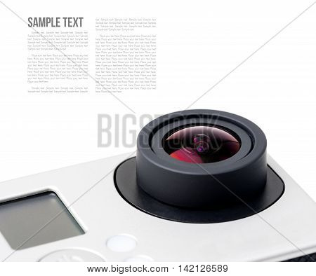 closeup lens of action camera over white background