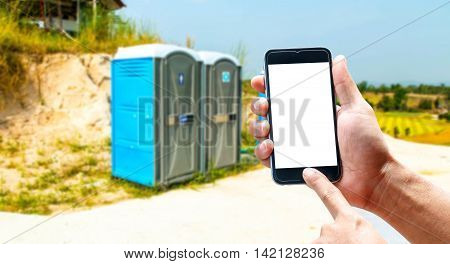 The blank screen of mobile phones, smartphones, portable toilet with a blurred background.