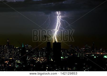 Dramatic thunder storm lightning bolt on the horizontal sky and city scape