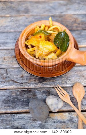 Thai food curry streaky pork with bamboo shoots in bowl earthenware