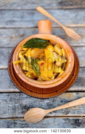 Thai food curry streaky pork with bamboo shoots in bowl earthenware top view