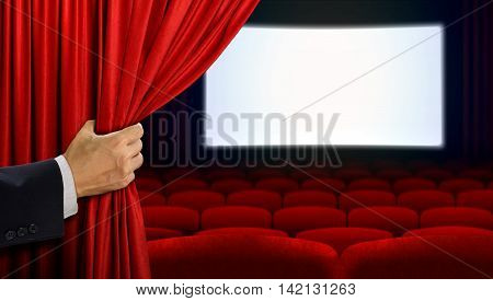 Hand opening curtain before movie show started