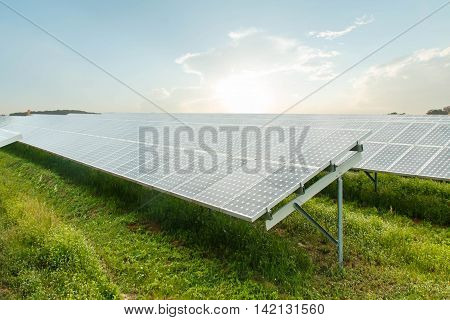 Photovoltaic modules on the background of and cloudy sky