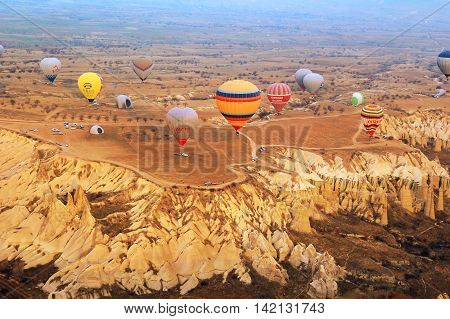 CAPPACOCIA TURKEY - FEB. 15 2016: Hot air balloon in the early morning during sunrise over the rock formations of Cappadocia Turkey