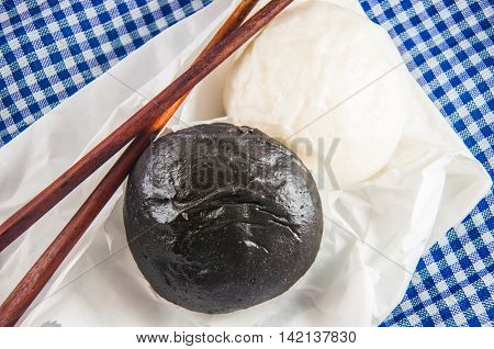 Black and white steamed bun and chopsticks