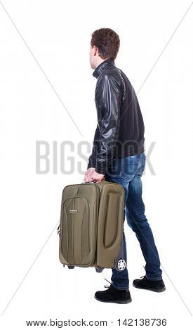 Back view of man with  green suitcase looking up. Rear view people collection.  backside view of person.  Isolated over white background. The traveler is carrying a suitcase ready to travel.