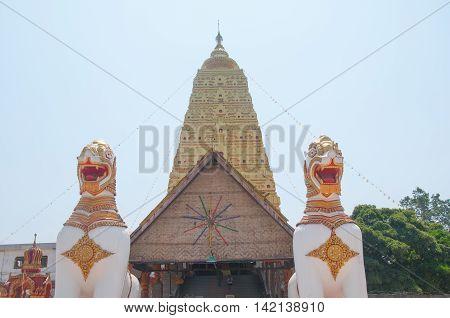 Two Lion guard statues in Wang Wiwekaram Thai temple Sangklaburi Kanchanaburi Thailand