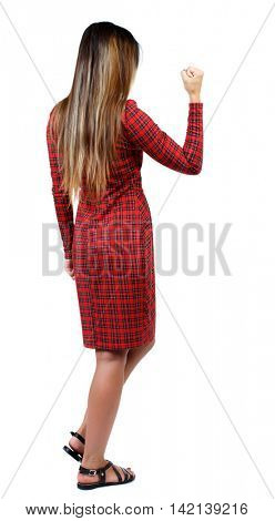 Back view of  business woman.  Raised his fist up in victory sign.    Raised his fist up in victory sign.  Rear view people collection.  backside view of person.  Isolated over white background. The