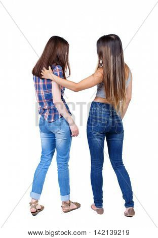 Back view of two young woman. Rear view people collection.  backside view of person. Rear view. Isolated over white background. Two young women are hugging.