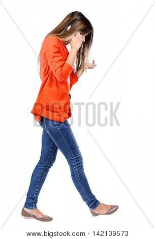 side view of a woman walking with a mobile phone. back view of girl in motion.  backside view of person.  Rear view people collection. Isolated over white background. girl in a red jacket is gesturing