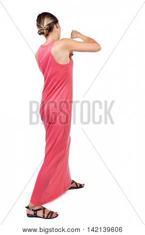 skinny woman funny fights waving his arms and legs. Isolated over white background. A slender woman in a long red dress fights.