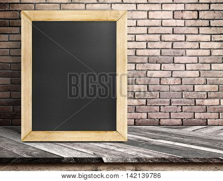 Blank Blackboard On Diagonal Wooden Table At Red Brick Wall,template Mock Up For Adding Your Design