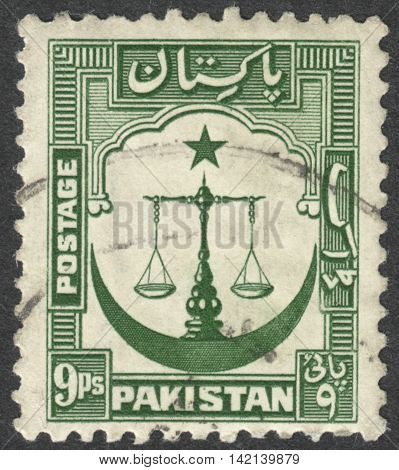 MOSCOW RUSSIA - CIRCA APRIL 2016: a post stamp printed in PAKISTAN shows Scales of Justice with Crescent moon emblem the series