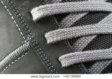 Detail of athletic shoes with laces close up