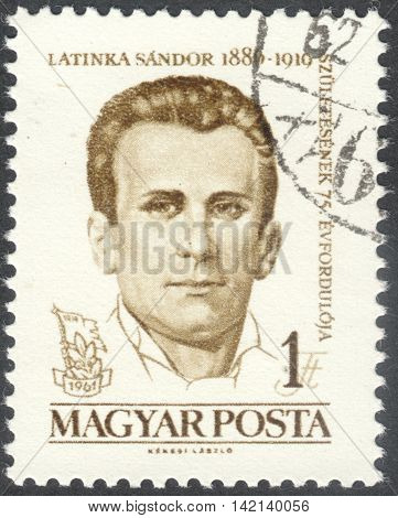 MOSCOW RUSSIA - CIRCA APRIL 2016: a post stamp printed in HUNGARY shows a portrait of Sandor Latinka dedicated to the 75th Anniversary of the Birth of Sandor Latinka circa 1961
