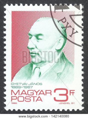 MOSCOW RUSSIA - CIRCA APRIL 2016: a post stamp printed in HUNGARY shows a portrait of Janos Gyetvai devoted to the 100th Anniversary of the Birth of Janos Gyetvai circa 1989