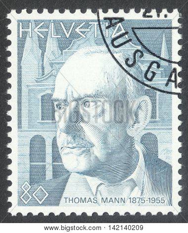MOSCOW RUSSIA - CIRCA APRIL 2016: a post stamp printed in SWITZERLAND shows a portrait of Thomas Mann the series