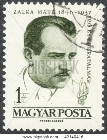 MOSCOW RUSSIA - CIRCA APRIL 2016: a post stamp printed in HUNGARY shows a portrait of Mate Zalka dedicated to the 65th Anniversary of the Birth of Mate Zalka circa 1961