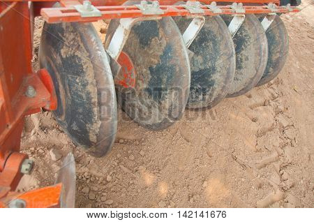 Ploughing heavy tractor during cultivation agriculture works