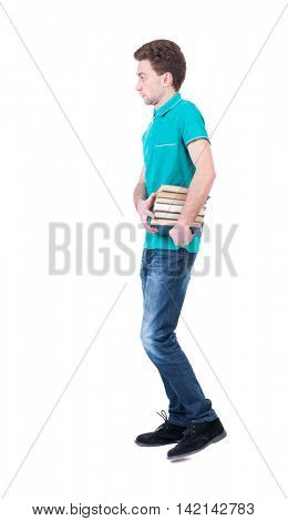 side view of going  man carries a stack of books. walking young guy . Rear view people collection.  backside view of person.  Isolated over white background. Curly man in a turquoise jacket goes to