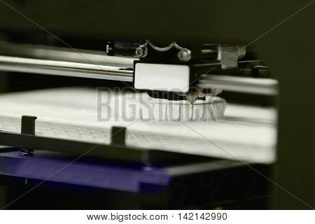 3D printer working,  color image, horizontal image