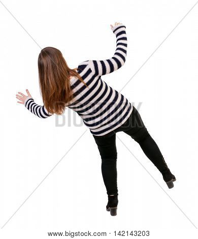 Balancing young woman.  or dodge falling woman. Rear view people collection.  backside view of person.  Isolated over white background. Girl in a striped jacket falls balancing on his left leg.