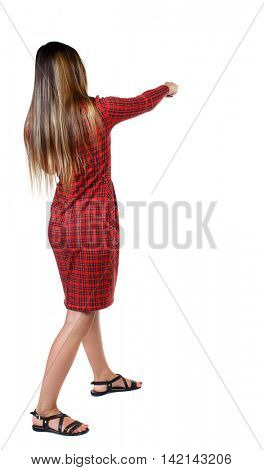 skinny woman funny fights waving his arms and legs. Isolated over white background. The girl in red plaid dress punches.