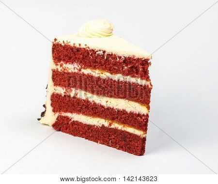 Red Velvet Cake piece white cream icing frosting on white background