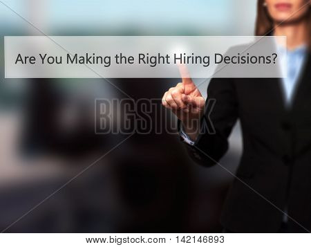 Are You Making The Right Hiring Decisions ? - Isolated Female Hand Touching Or Pointing To Button