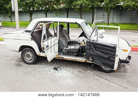 Crushed White Vaz-2106 Car With Broken Windows