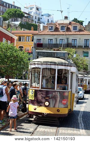 Lisbon, Portugal - July 29, 2016: The famous Tram on line 28, serves the municipality in Lisbon. Now mostly Tourists. Its a great Attraction in the capital city of Portugal