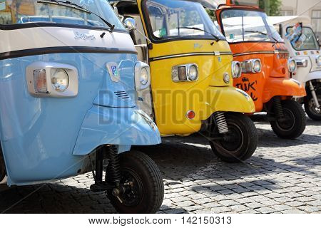 Lisbon, Portugal - July 29, 2016: Tuk Tuk Taxis in front of Lisbon Cathedral are waiting for Tourists in Lisbon. Portugal