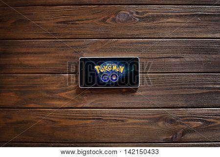 Vinnitsa, Ukraine. - August 12: Smartphone on a wooden board with Pokemon Go logo, August 12, 2016 in Vinnitsa, Ukraine