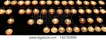 Many Candles Inside The Place Of Worship