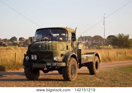 WESTERNHANGER, UK - JULY 20: An ex German army Mercedes military truck heads toward one of the back fields after official show hours at the War & Peace Revival show on July 20, 2016 in Westernhanger