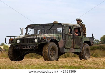 WESTERNHANGER, UK - JULY 21: An ex US army Hummer vehicle parades around the arena for the public to watch at the War & Peace Revival show on July 21, 2016 in Westernhanger