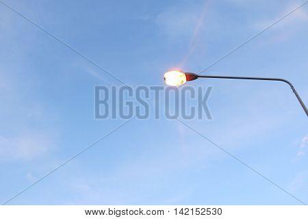 light pole under the blue sky .