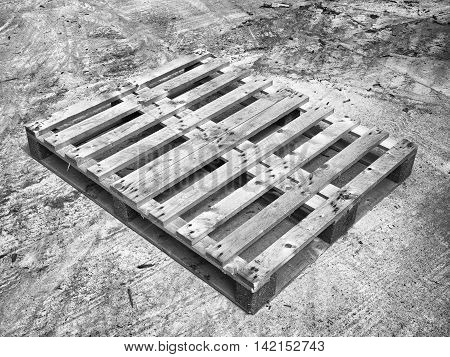 Wooden Pallet On Worn Out Concrete Ground. Empty Pallet