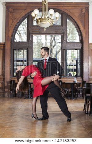 Professional Tango Dancers Performing In Restaurant