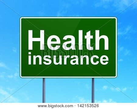 Insurance concept: Health Insurance on green road highway sign, clear blue sky background, 3D rendering