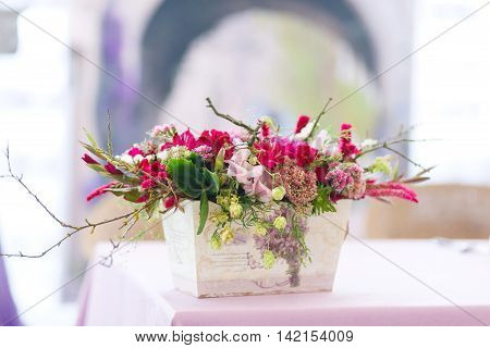 Beautiful flowers bouquets decor in vase. Wedding decor in pastel violet colors