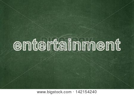 Entertainment, concept: text Entertainment on Green chalkboard background