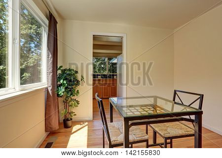 Dining Wicker Chairs With Glass Table By The Window.