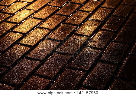 Stone pavement texture. Granite cobblestoned pavement background. Abstract background of old cobblestone pavement close-up.