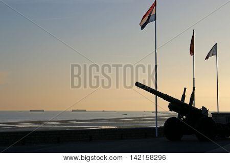 Gun at Arromanches beach, Normandy, at dawn