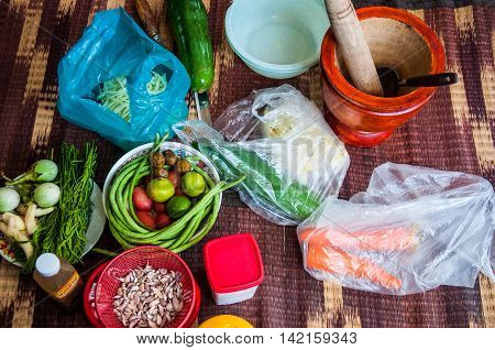 Thailand Food Ingredients: many vegetable with a mortar for cooking papaya salad