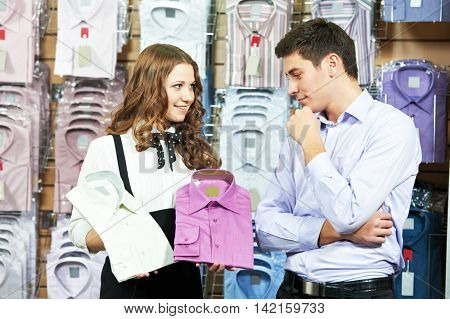 man and assistant at apparel clothes shopping