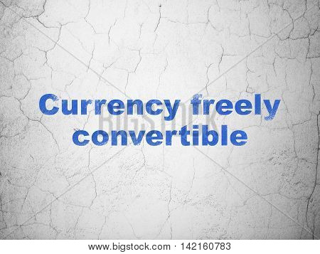 Currency concept: Blue Currency freely Convertible on textured concrete wall background